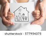 child and adult person holding... | Shutterstock . vector #577954375