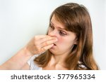 young woman holding her nose  ... | Shutterstock . vector #577965334