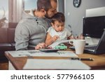 father kissing son at home... | Shutterstock . vector #577966105