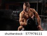 man with dumbbells | Shutterstock . vector #577978111