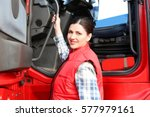 young female driver near big... | Shutterstock . vector #577979161