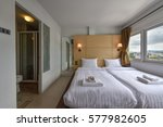 interior of a hotel bedroom | Shutterstock . vector #577982605