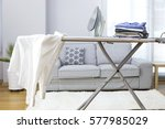 ironing clothes on ironing board | Shutterstock . vector #577985029
