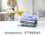 ironing clothes on ironing board | Shutterstock . vector #577985065
