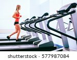 active young woman running on... | Shutterstock . vector #577987084