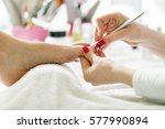 beautician doing pedicure. | Shutterstock . vector #577990894