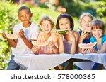 childrean eating healthy melon...   Shutterstock . vector #578000365
