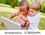 Children With Laptop Having Fu...