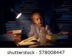 a pretty little girl reading a... | Shutterstock . vector #578008447