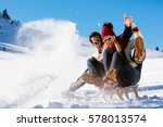 young couple sledding and...   Shutterstock . vector #578013574