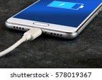 mobile smart phones charging on ... | Shutterstock . vector #578019367