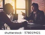 businessman blaming his... | Shutterstock . vector #578019421