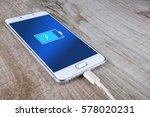 mobile smart phones charging on ...   Shutterstock . vector #578020231