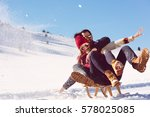 young couple sledding and... | Shutterstock . vector #578025085