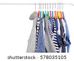 clothes on hangers on white... | Shutterstock . vector #578035105