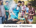 friends having a barbecue party ... | Shutterstock . vector #578059441