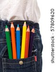Colored pencils in kids jeans pocket - closeup - stock photo