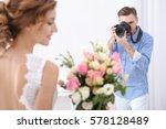 wedding photographer taking... | Shutterstock . vector #578128489