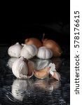 Garlic Head On A Background Of...