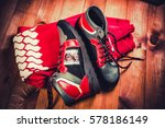 red men's shoes on a wooden... | Shutterstock . vector #578186149