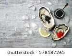 opened oysters with red salmon... | Shutterstock . vector #578187265