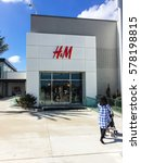Small photo of HOUSTON, US-FEB 12, 2017: Customer enter H&M Store at Willowbrook Mall, a regional shopping mall. H&M is an international fashion retail corporation, second largest global clothing retailer after Zara