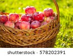 Red Apples In A Basket On A...