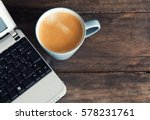 cup of coffee next to a small... | Shutterstock . vector #578231761