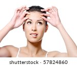 Portrait of young woman in horror because of crease on her forehead - close-up - stock photo