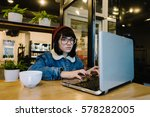 young hipster girl uses the... | Shutterstock . vector #578282005