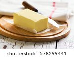 butter block on wooden board.... | Shutterstock . vector #578299441