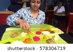 Small photo of Fouzia Farook eating traditional Kerala sashay meals from kairali restaurant East Ham, United Kingdom on 14 Aug 2014