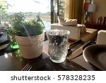 glass and dish on the table in... | Shutterstock . vector #578328235