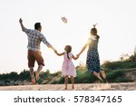 family playing on the beach | Shutterstock . vector #578347165