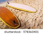 two surfboards on sandy beach | Shutterstock . vector #578363401