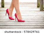 female legs in red patent... | Shutterstock . vector #578429761