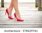 female legs in red patent... | Shutterstock . vector #578429761