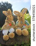 Small photo of easter bunny sitting in a sunshine