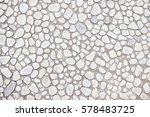 white wall of small stones ...   Shutterstock . vector #578483725