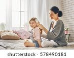 happy loving family. mother is... | Shutterstock . vector #578490181