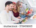 happy young family preparing...   Shutterstock . vector #578498005