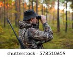 Hunter Observing Forest With...