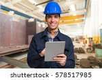 smiling engineer using a tablet ... | Shutterstock . vector #578517985