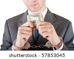 greedy manager with cash and handcuffs - stock photo