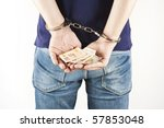 criminal prisoner with handcuffs and bills in his hands - stock photo