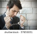 portrait of a manager with handcuffs - stock photo