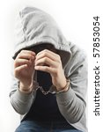 hooded man with handcuffs - stock photo