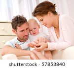 young  happy family in a room... | Shutterstock . vector #57853840