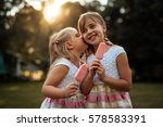 sisters eating an ice cream... | Shutterstock . vector #578583391