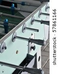 Closeup on foosball table with handles, coin slot and players - stock photo